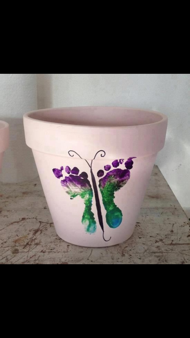 Kid's footprints on a pot. Great Mother's Day gift! These are happening :)