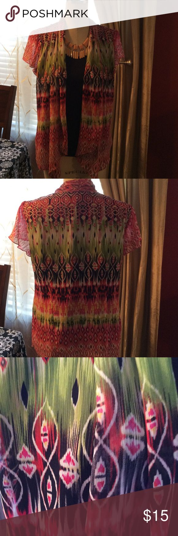 2 Piece Connected Short Sleeve Tribal design sheer short sleeved flowing blouse connected to black tee style top.  Colors of green, pink, and some peach. Sara Michelle Tops Blouses