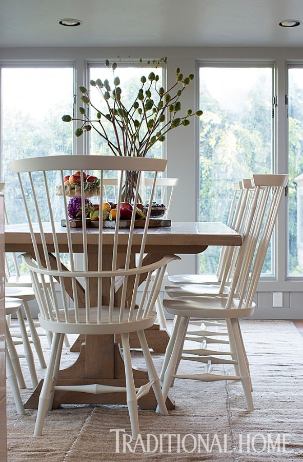Large-scale takes on the classic Windsor chair gather around a custom table for a casual dining spot. - Photo: Terri Lynn Fisher / Design: Frances Merrill