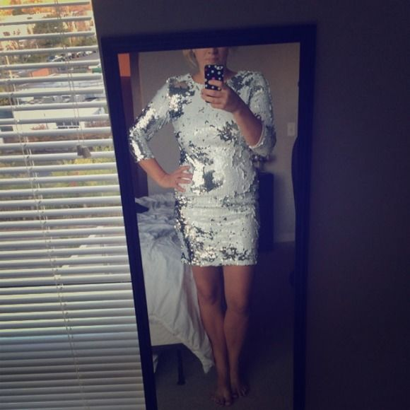 White Sequin Dress Perfect for NYE or a trip to Vegas! Long sleeved white sequin dress with cutout in the back. Super glam, yet comfortable! Only worn once, in perfect condition. TFNC London Dresses