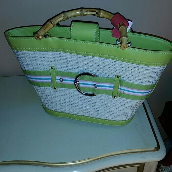 Basket Purse Bath and Body Works So cuter for spring and summer! Wicker like body with buckle detail. I loved this purse! Red tag is from dry cleaner Bath & Body Works Bags