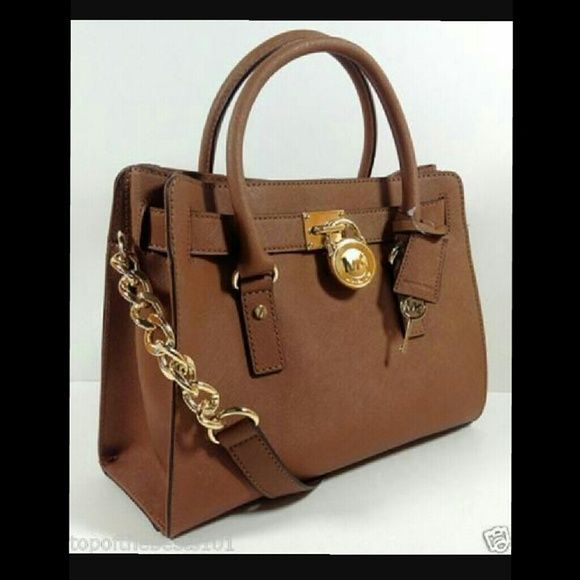 Micheal kors Hamilton bag Brand new still wrapped micheal kors Hamilton bag color is brown with gold hardware Michael Kors Bags Shoulder Bags