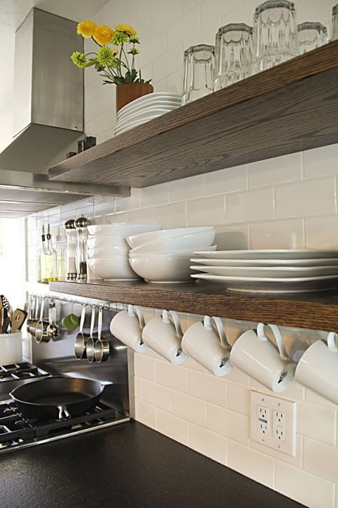 Floating shelves are super chic and practical, but forgetting to use the underside is a common mistake. Hang mugs underneath to eke out every drop of storage. Click through for more kitchen organization tips for the storage spots you're forgetting to use.