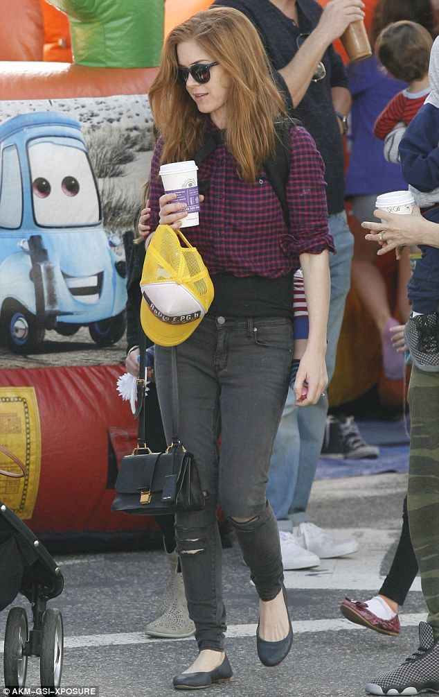 Practical styling: Isla opted to wear purple and red flannel shirt, which she wore with th...