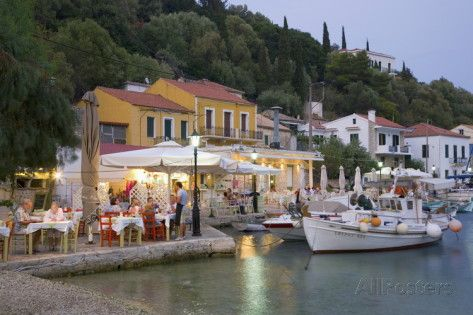 Typical Waterfront Taverna Illuminated at Dusk, Kioni, Ithaca (Ithaki) Photographic Print by Ruth Tomlinson at AllPosters.com