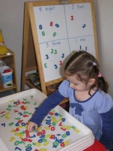 Number Sort - A fun number activity! Searching for numbers and sorting them into groups on a magnetic board.
