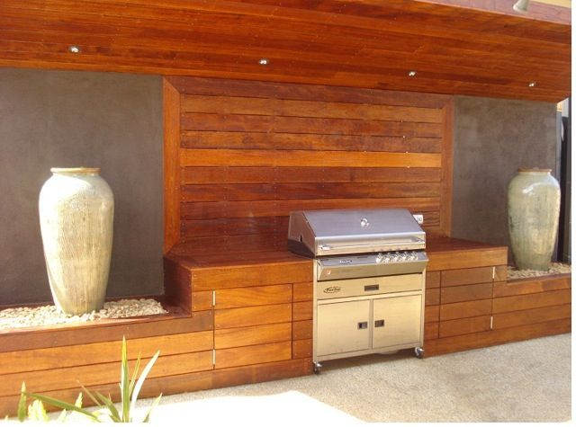 Image result for cement bbq island with wood doors