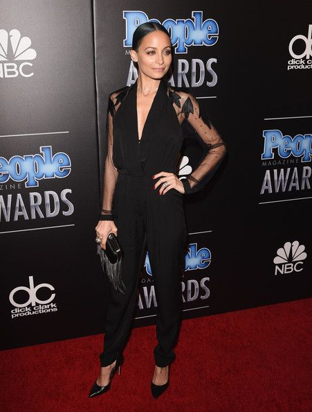 3. Nicole Richie Nicole Richie rocked her signature dark, romantic look in a black jumpsuit with sheer sleeves.