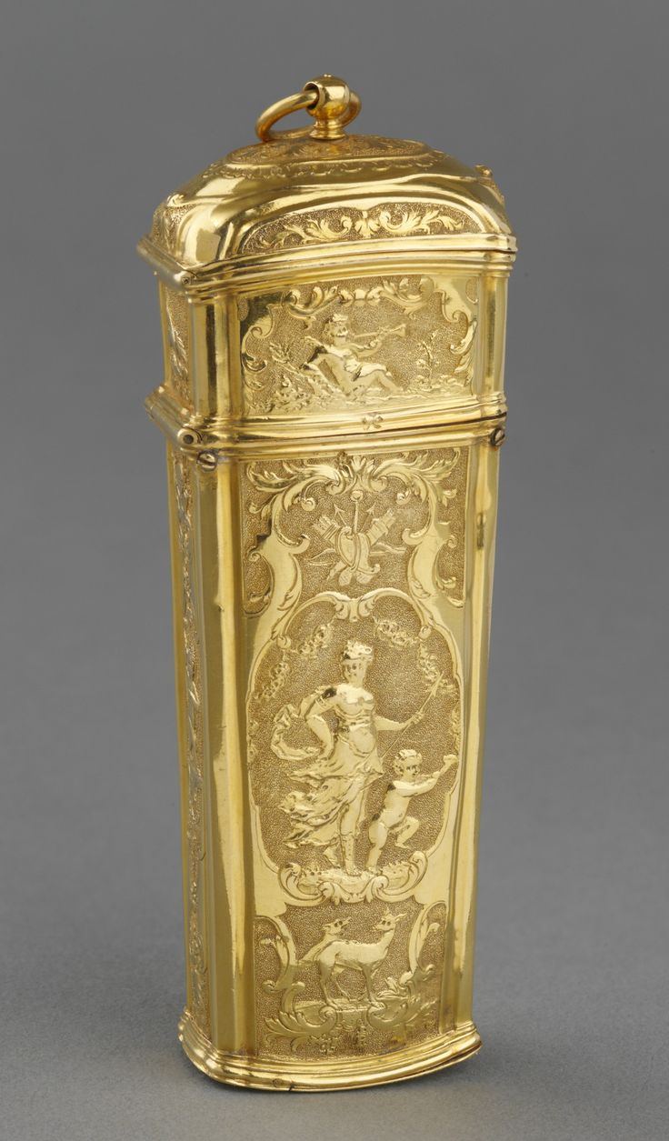 """Étui, French, Creation Date: 1722 - 1727, Gold Dimensions: 11.6 x 3.7 x 2.4 cm """"Tapering rectangular étui with fittings of repoussé gold. Front and back chased with hunting figures with putti and trophies. Domed hinged lid, press stud opens main compartment, fitted mirror in lid. Base opens to reveal a thimble."""" Royal Collection Trust/© Her Majesty Queen Elizabeth II 2014"""