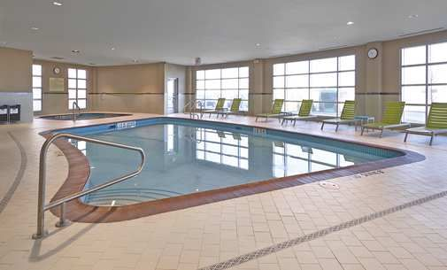 Homewood Suites by Hilton Calgary-Airport, Alberta, Canada - Indoor Pool. At airport. Kitchen has only a 2 burner hot plate. Suite has one king, two queen beds. $250 per night.