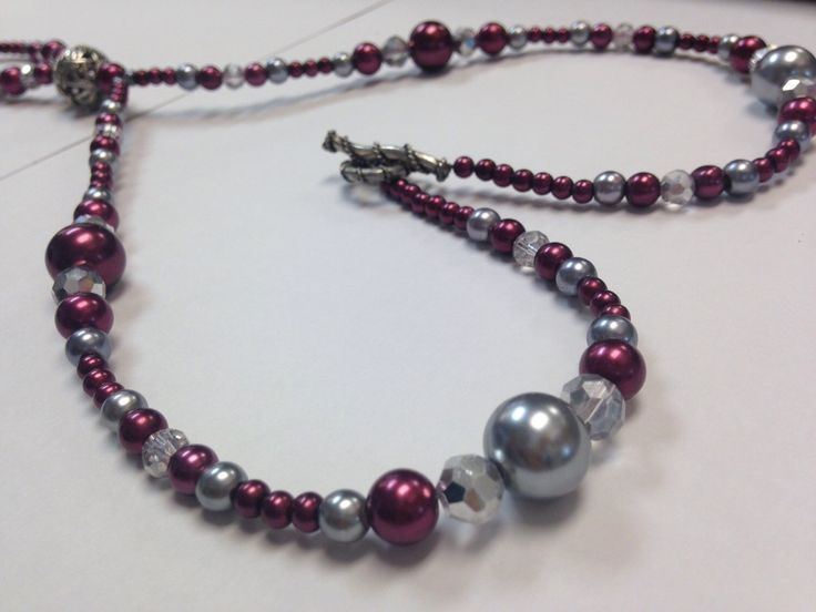 A personal favorite from my Etsy shop https://www.etsy.com/listing/253942755/maroon-purple-and-silver-pearl-lanyard