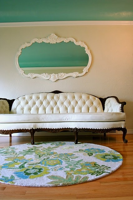 pleather refurbished couch. I'm in love with the couch and the mirror above it. perfection.