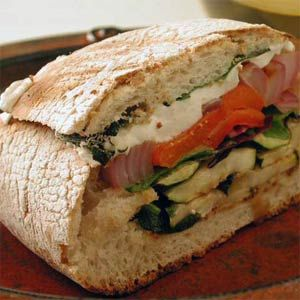 Grilled Vegetable and Mozzarella Sandwiches Hollow out a loaf of Italian ciabatta bread and fill it up with grilled veggies, salad greens and cheese for a complete meal.