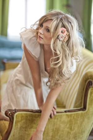 Long wavy hair with flowers; combo of highlights and lowlights again --AND great side swept bangs