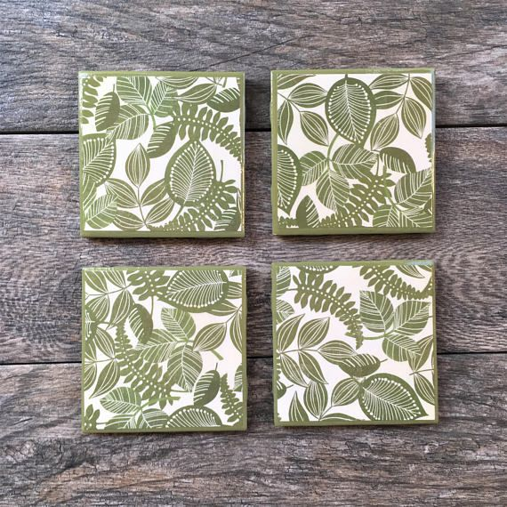 Beautiful handmade coasters with a palm tree leaf pattern. They are chic, trendy, and will look good in any home. They are waterproof, heatproof, and have cork on the bottoms to make them scratch proof on your tabletop. They are each 4.25 wide x 4.25 long, and roughly 0.5 tall, and come in a set of four. These coasters will look great in your home and will last for many years.