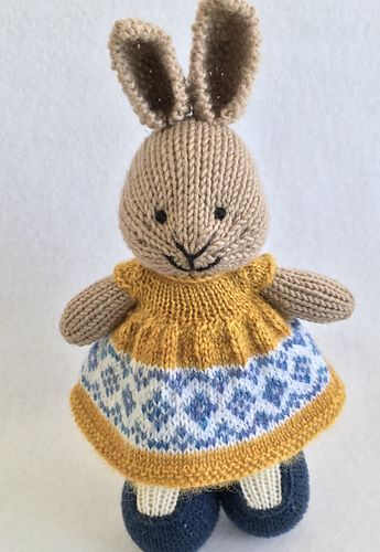 Yellow tulips in a blue and white pitcher inspired this spring dress. This dress was knit with a long cast on of 96 stitches. I used 8 repeats of the chart pictured on the left. I knit the dress u...