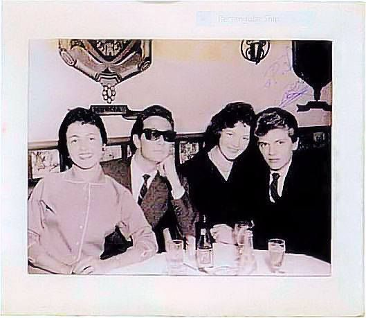 INCREDIBLY rare photograph of Buddy Holly with his wife Maria Elena (just after being married) and Phil Everly and his wife Jackie. Taken in New York at El Chico restaurant. This copy was made from the only known photo of these 4 together and it was one of Buddy Holly's favorite photographs. Note - the autograph in the upper right corner has been purposely altered. https://cassymuronaka.wordpress.com/page/18/