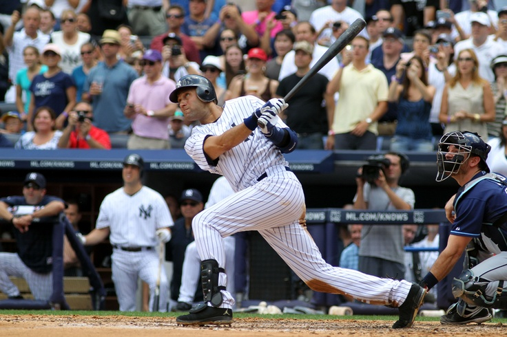 Derek Jeter of the New York Yankees hit a solo home run in the third inning for his 3,000th career hit while playing against the Tampa Bay Rays at Yankee Stadium in New York on July 9.