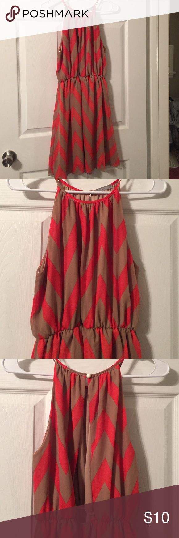 Tan and orange chevron dress Tan and orange chevron dress. Size small. Elastic at waist and has open back with white button. From Charlotte Russe. Blue S LA Dresses Mini