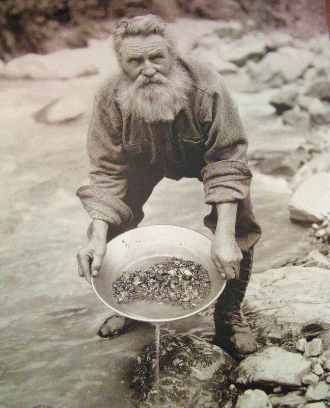 This miner is illustrating the meaning of panning panning for Alaskan cuisine history
