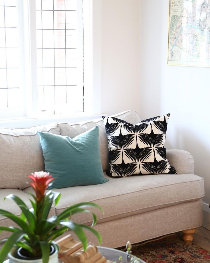 """Got home from my trip yesterday and spastically took down all my window treatments ( post travel inspiration?). It's time for something new no idea what but have started by adding my new favourite """"Flock"""" pillow to my sofa. Like the direction? #mytonicliving"""