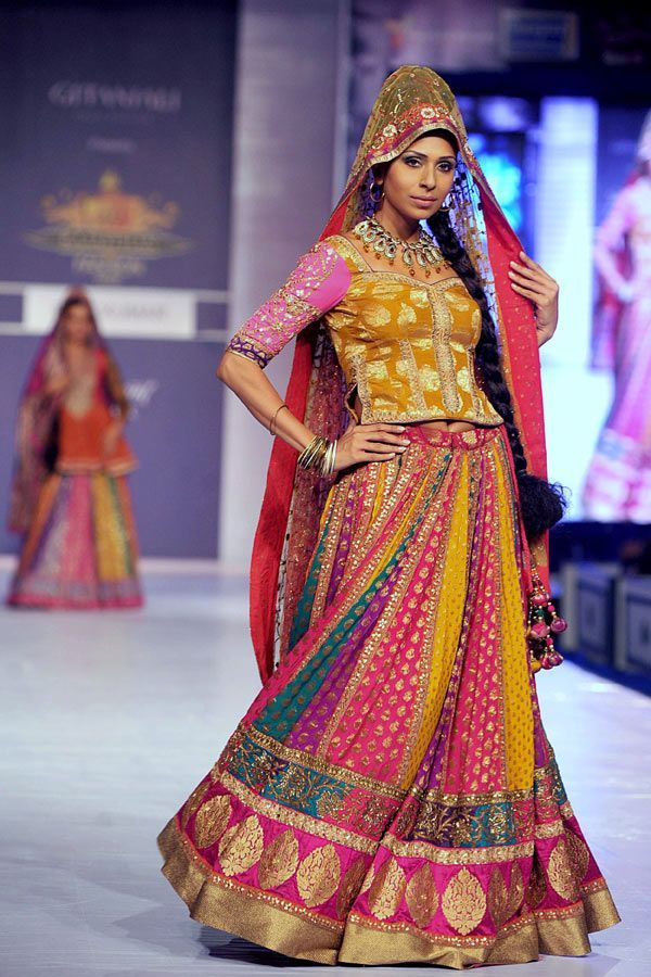 Candice Pinto showcases a creation by designer Ritu Kumar during a fashion show at the Rajasthan Fashion Week (RFW) 2013 in Jaipur on May 11, 2013.