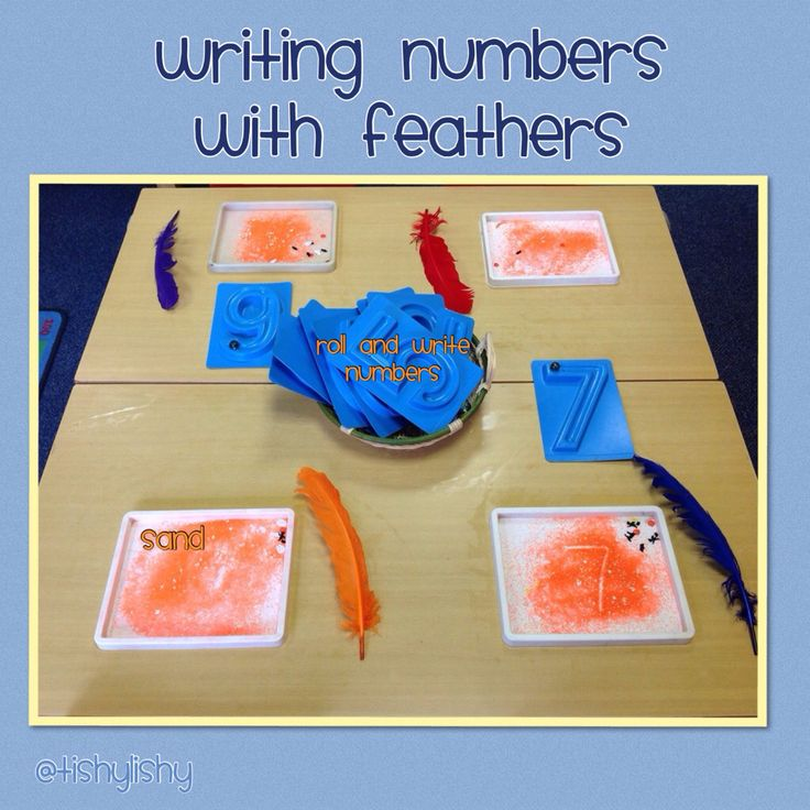 Writing numbers in sand with feathers