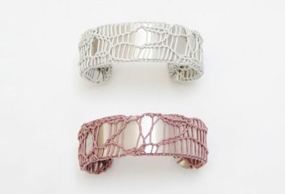 These lovely and unique brass cuffs are encased in a web of knitted cord and are made by Wade Jensen and Moire Conroy in NYC. They are available in either grey or lavender and have been featured in Vogue magazine. $160
