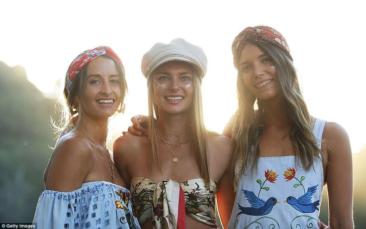 Printed ensembles were a popular choice with many festival-goers on Sunday, along with hat...