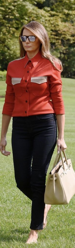 First Lady Melanie Trump in Calvin Klein shirt and J. Brand jeans carries Hermes bag on return from Camp David on 9/10/17