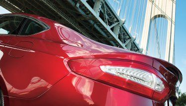 The 2015 Ford Fusion Titanium shown in Ruby Red Metallic Tinted Clearcoat.