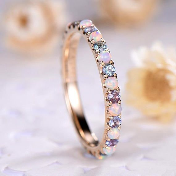 This is an opal engagement ring yellow gold. The stones are natural Opal, Alexandrite This opal is about 2mm round cut,full eternity design. The stones can be replace with other gemstones.For example,if you dont like the amethyst accent,you can ask me replace it with