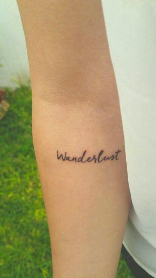 'Wanderlust' tattoo on forearm via Pau Soto