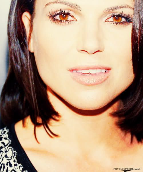 Lana Parrilla as Moghedien She is sturdily handsome with shoulder-length hair worn loose. She has large, dark eyes and smooth cheeks