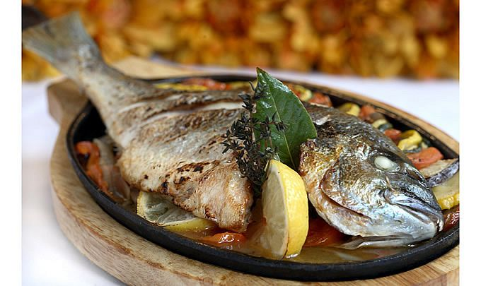 19. Their fish swims 3 times: in the sea, in olive oil (during cooking) and in wine (during meal)