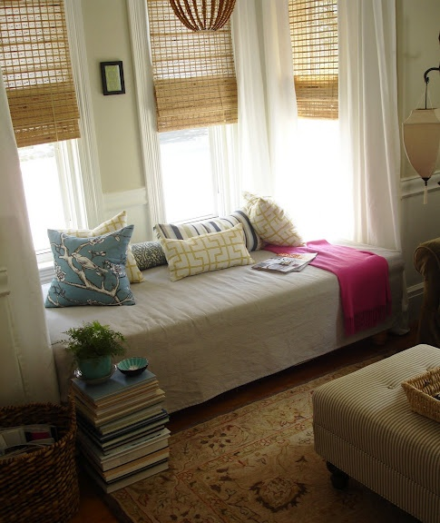 daybed window nook; out bed under window and surround with bookshelves and curtains; along with lights maybe?