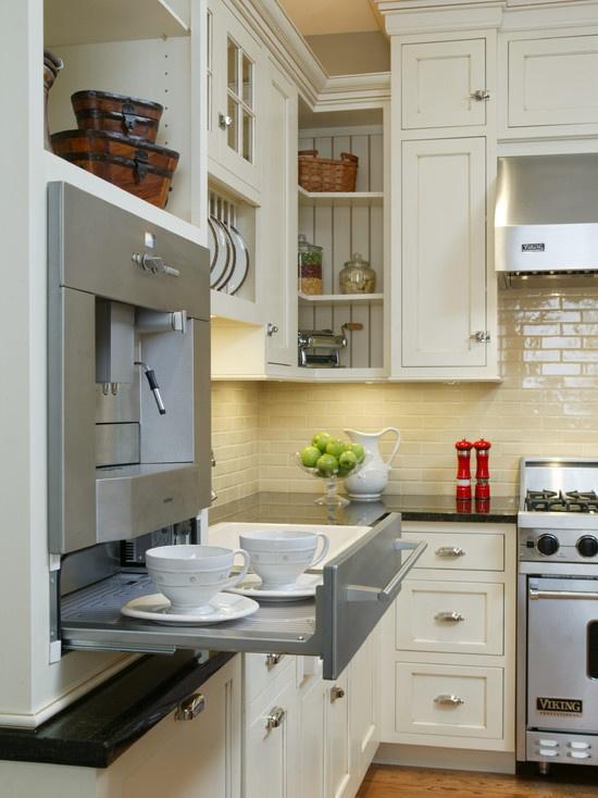 Built-in Gaggenau coffee machine with warming drawer below