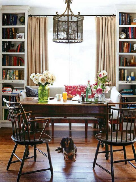 love the multi-purpose dining room; the upholstered bench between bookcases; the light fixture!