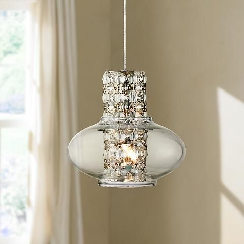 Illuminate your home with this modern crystal mini pendant surrounded by a charming formed clear glass