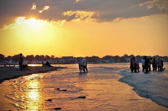 Wading at Wollaston Beach as the sunset approaches. AMELIA KUNHARDT/The Patriot Ledger: Patriots Ledger, Kunhardt Th Patriots, Amelia Kunhardt Th, Sunsets Approach, Wollaston Beaches