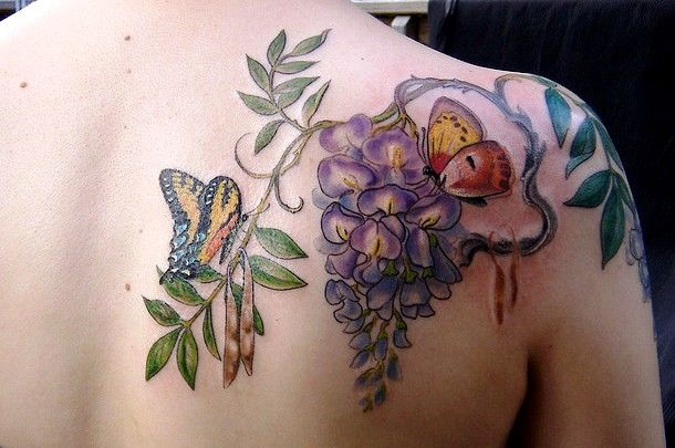 Butterfly fairy tattoos butterfly koi fish tattoo for Butterfly koi tattoo
