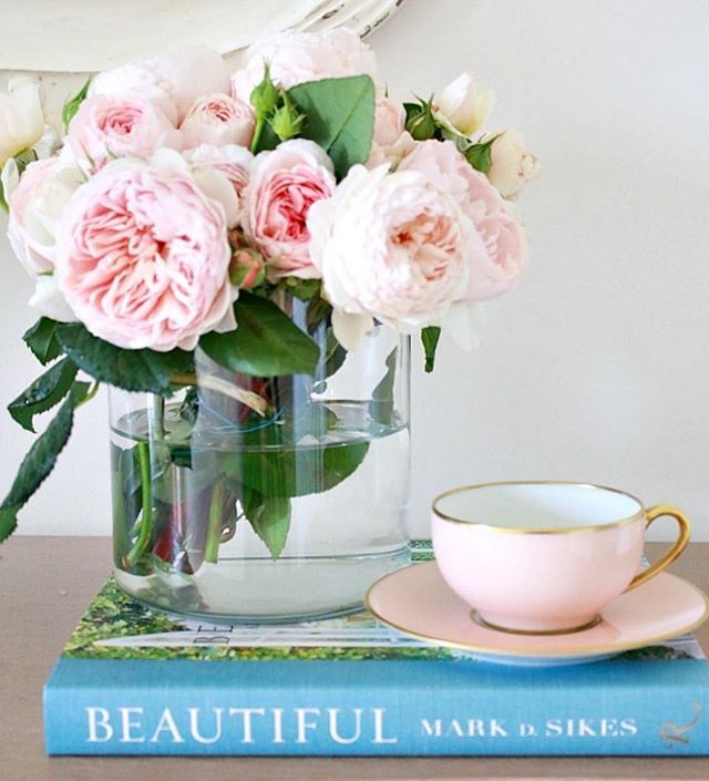 """Pink David Austin roses, with Mark D. Sikes book """"Beautiful""""."""