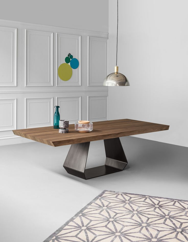 "The ""gritty"" business man lives in a loft in Milan. For his house he has chosen AX with walnut top and pickled finish metal base: a bold, unusual, gritty choice. Metals such as steel, brass, copper, corten can make a home original and unique. In combination with more traditional materials, such as wood, it may be a valid solution for those looking for a classy yet warm and lively style. Here are some ideas to give a gritty touch to your home. #bonaldo #adv #AX #metal #gritty"