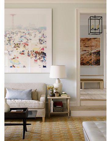 In the living room, a beach scene by Massimo Vitali reads almost like a view.