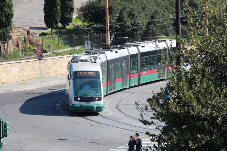 A Roma 2 Tram bound for Ostiense rounds a curve just outside the Colosseum in Rome. #tram #train #lightrail #colosseum