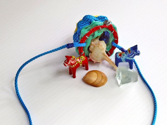 Tiny recycled ghost net basket and its treasures