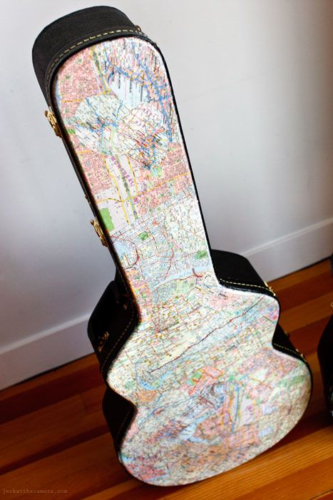 Decoupage a guitar case with maps. I want to do this with a map of Paris or maybe the Loire region of France. :)