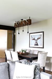 Rustic country or hunting decor in a dining room. Benjamin Moore Grant Beige. Design by Color Consultant Kylie M Interiors