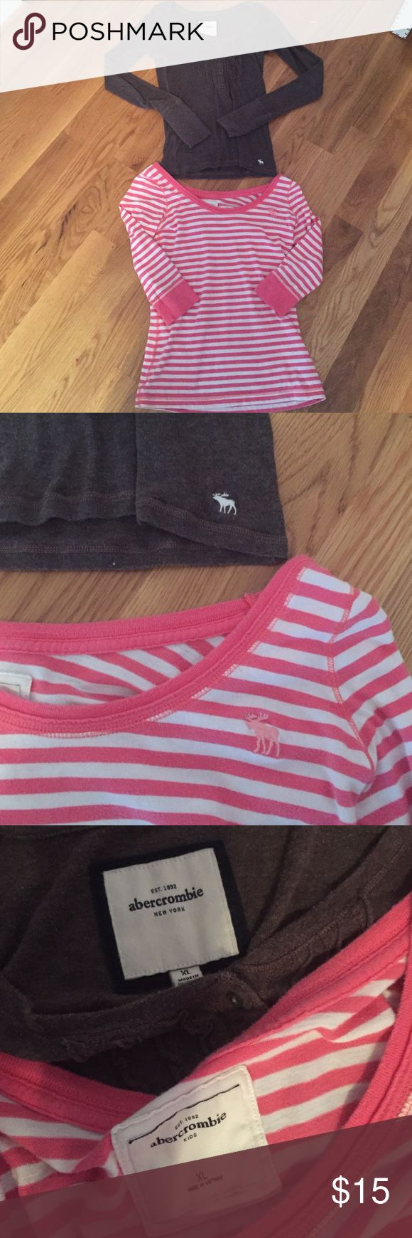 Abercrombie shirts XL in kids, so fits probably a XS or S in women's. First shirt is pink and white stripes. Second is brown with buttons, and a v neck that cuts down kind of low. Both are tight fitting. The brown fits a little smaller the the pink and white. Lightly worn, but still in very good condition. Feel free to make offers! Abercrombie & Fitch Tops Blouses