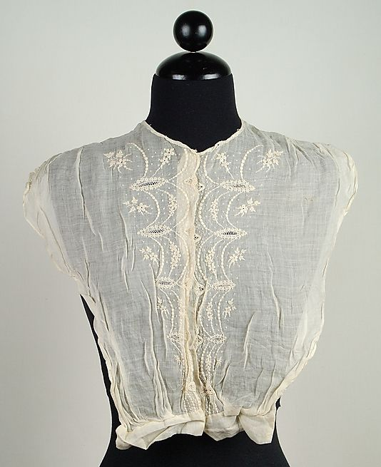 A chemisette was a versatile chest piece worn under daytime dresses. They worked to raise the neckline of the dress and protect the bodice of the dress from body oils (while still being fashionable accessory)